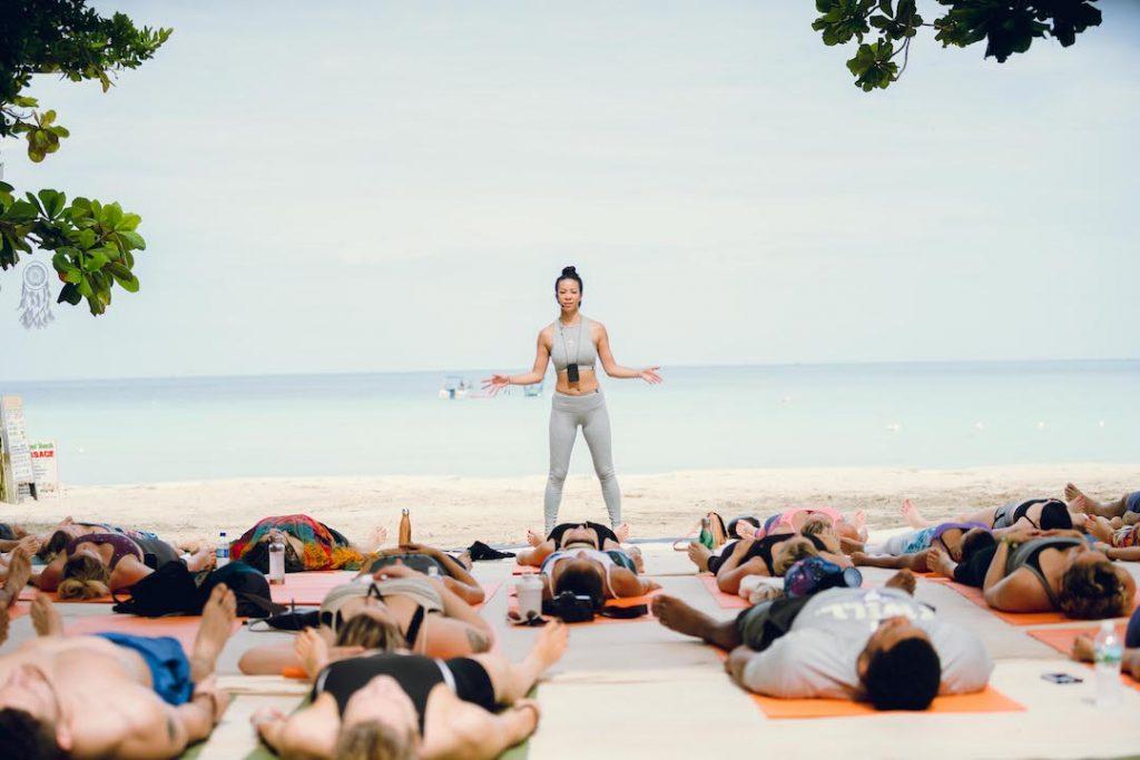 Irie Soul's Stacy leading a yoga/meditation class ~ Savasana ~ Photo by Corey Hamilton